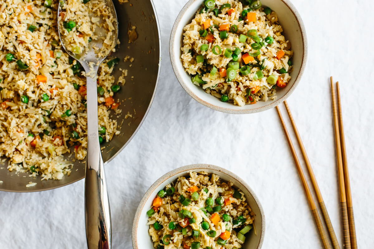 Serving portions of cauliflower fried rice.