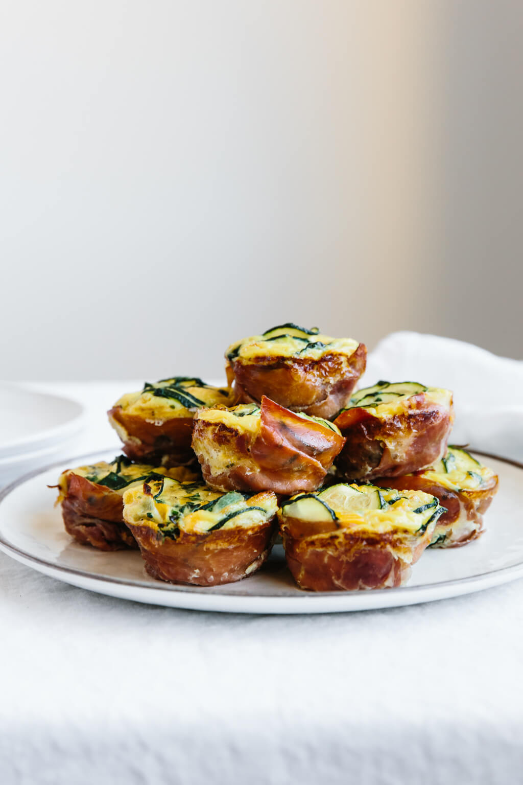 Stack of egg muffins on a plate