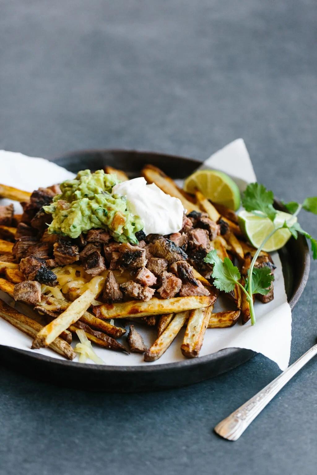 Carne asada fries on a plate.