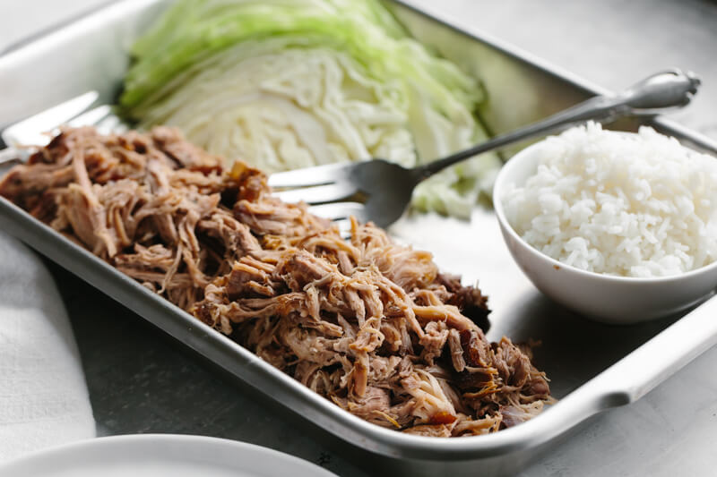 (gluten-free, paleo) This slow cooker kalua pork (kalua pig) is deliciously tender, smoky and salty and super easy to make.
