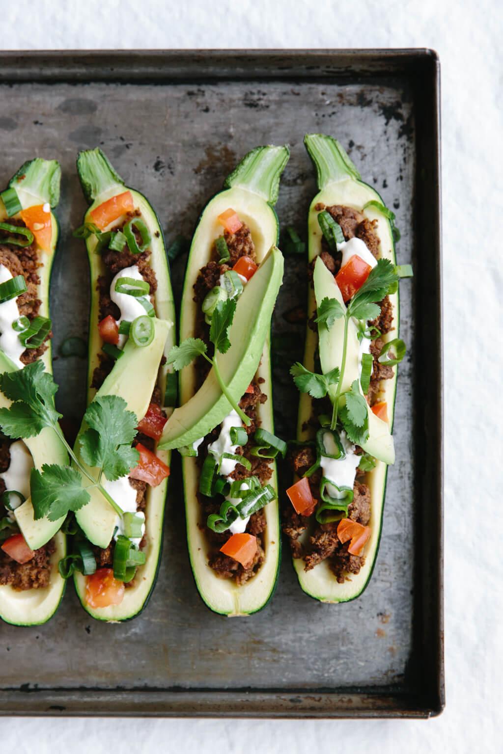 Zucchini boats on a baking sheet.