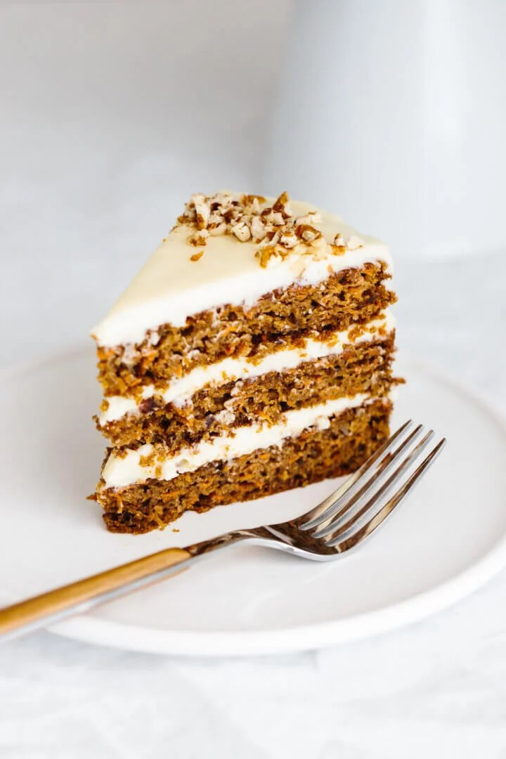 A slice of carrot cake on a plate.