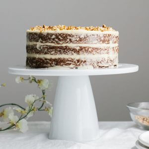 This gluten-free carrot cake (which is also paleo) is a rustic naked cake, topped with ultra creamy cream cheese frosting and pecans.