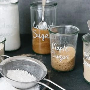 Different types of sugar in jars.