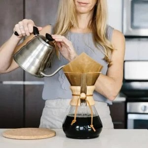 Learn how to brew coffee in a Chemex Coffee Maker! Here's step-by-step instructions along with a tutorial video and tips on filters and how to clean your Chemex.
