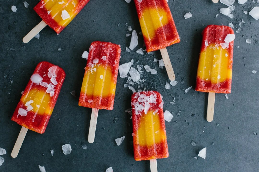 Mango strawberry popsicles are the perfect homemade popsicle recipe to usher in warmer spring weather with delicious, seasonal fruit.