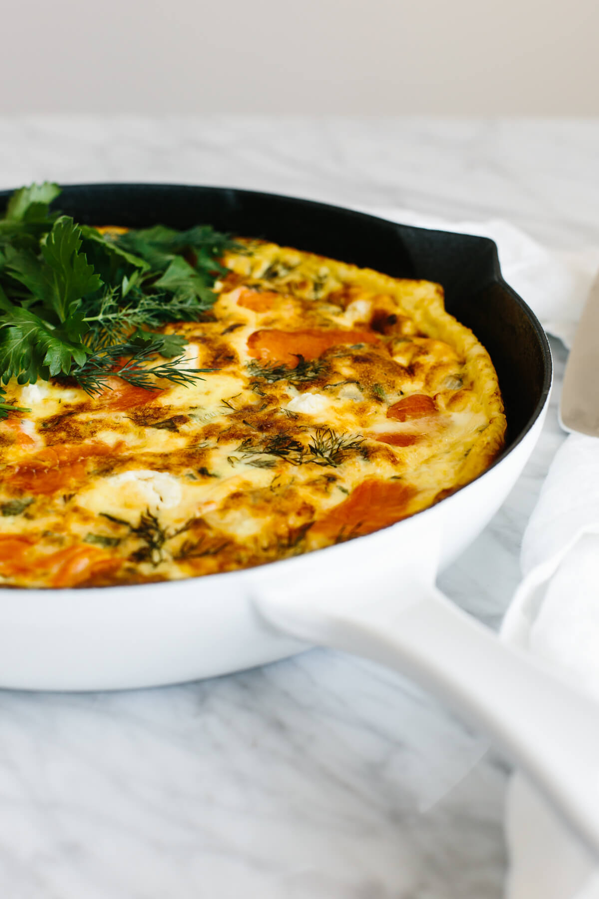 Smoked salmon frittata in a pan.