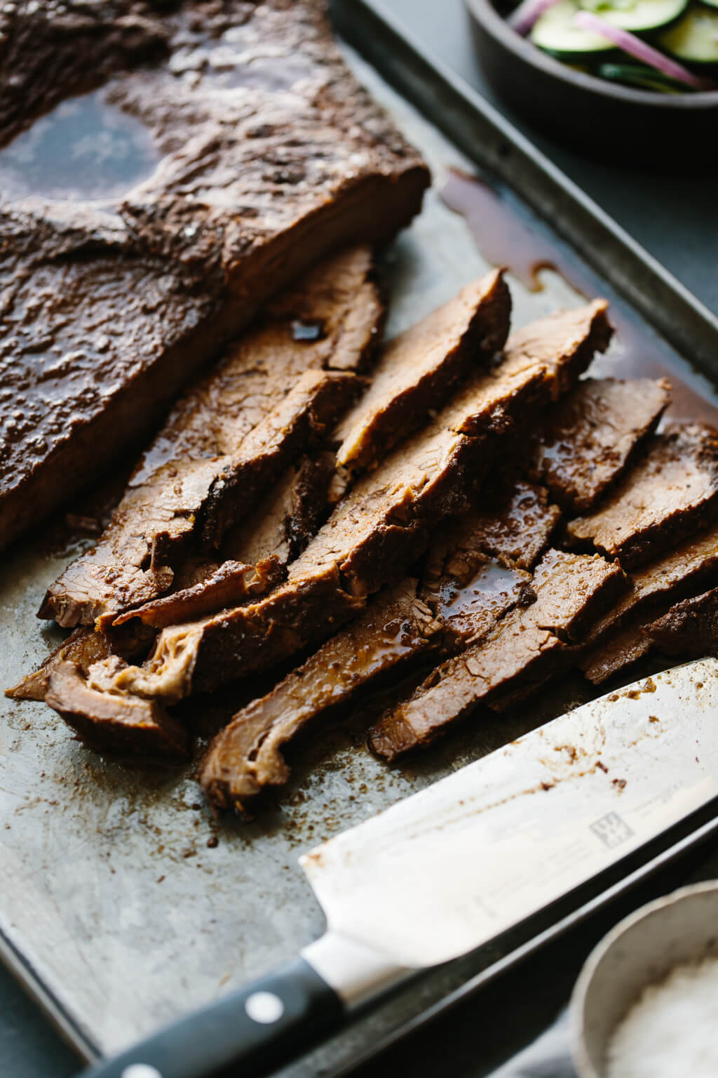 An easy, oven braised brisket that's the perfect combination of sweet and smoky. After a few hours in the oven, you'll have juicy, tender beef brisket.