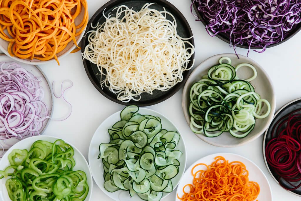 The spiralizer is one of my favorite kitchen tools. So today I'm sharing my favorite vegetables to spiralize along with veggie spiralizer tips and recipes. Learn how to spiralize - it's easy!