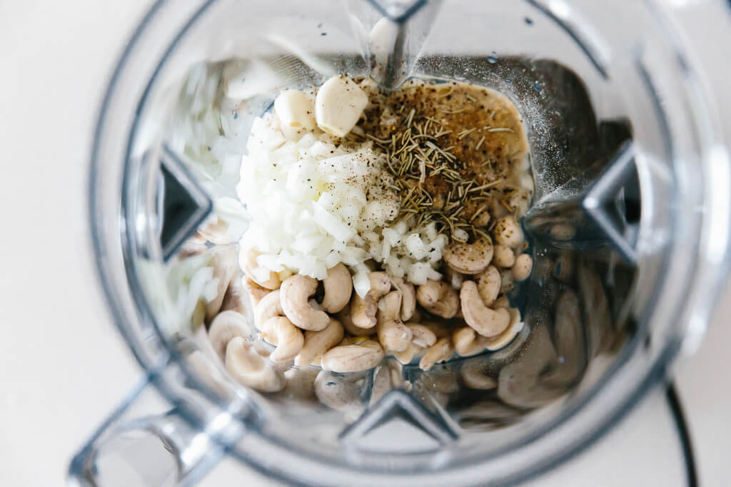 Vegan alfredo sauce ingredients in a blender.