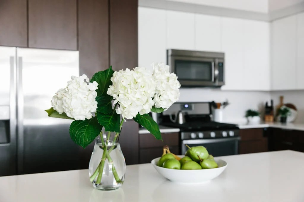 Creating a Minimalist Kitchen. My kitchen is a blend of cozy minimalist, warm modern, Scandinavian and SoCal design. Here are 8 tips to help you clean, declutter and embrace a little minimalism.