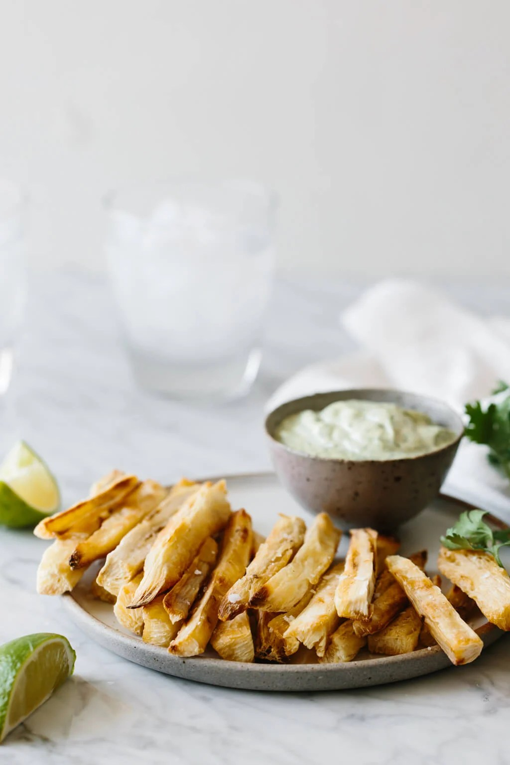 Baked yuca fries (also known as cassava fries) are golden and crispy on the outside and soft on the inside. They're a healthier way to make yuca fries and I'm serving them up with cilantro lime mayonnaise.