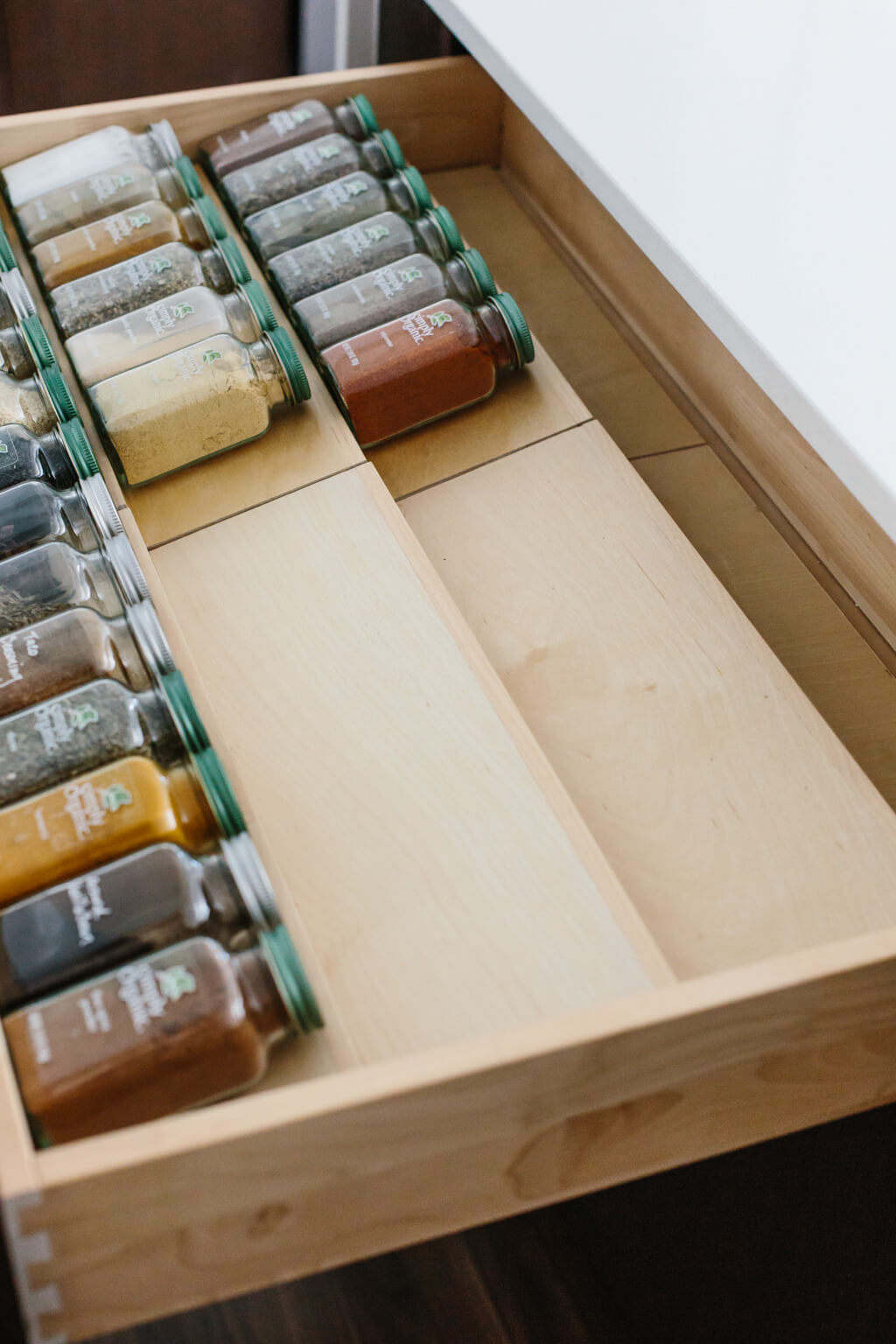 My spice drawer is pivotal to cooking healthy recipes. So today I'm sharing how I organize my spice drawer and giving you a few tips for dried spices. #SpiceOrganization #SpiceDrawer #SpiceRack #KitchenOrganization #KitchenIdeas