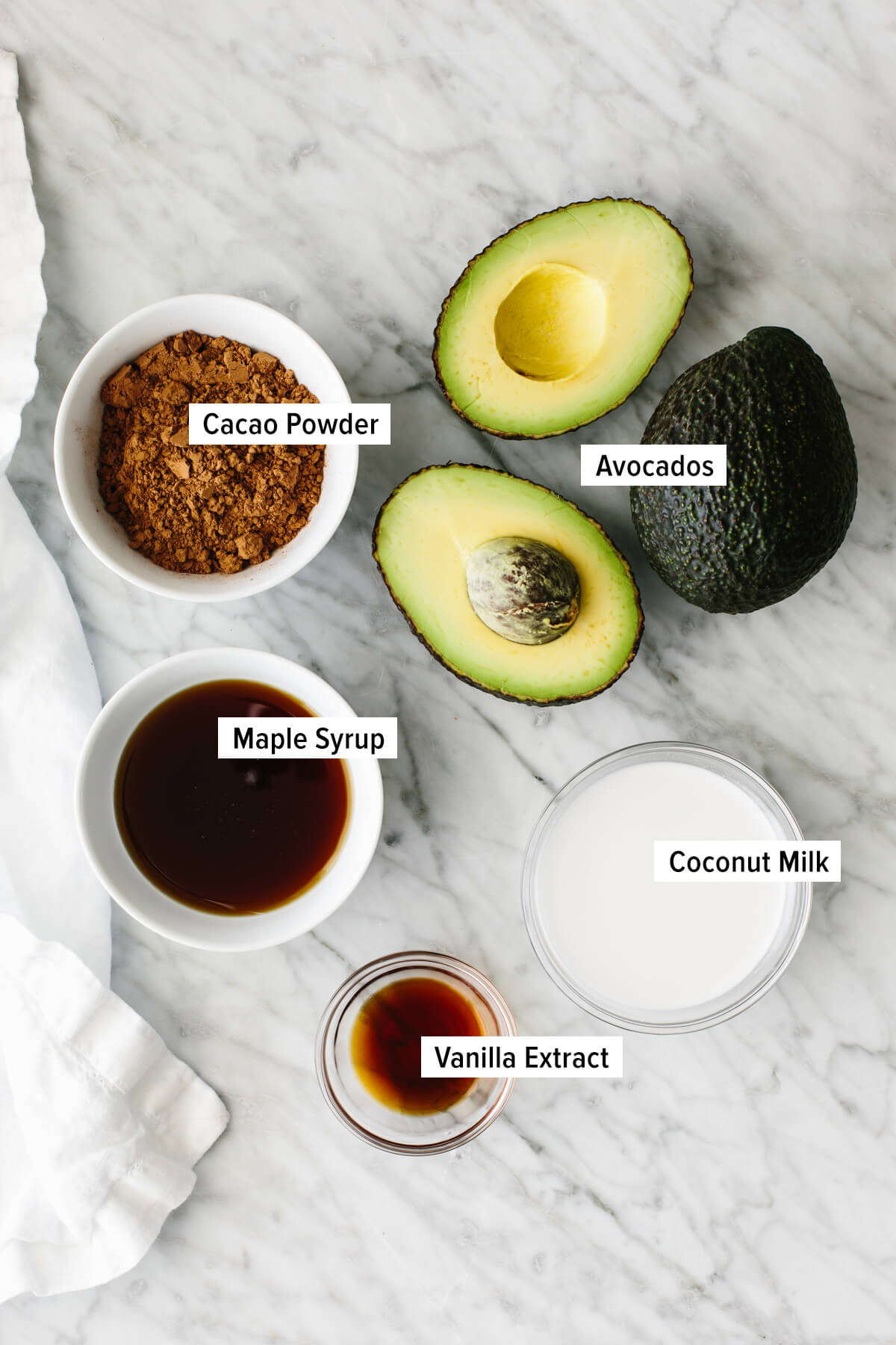 Chocolate avocado pudding ingredients on a countertop.