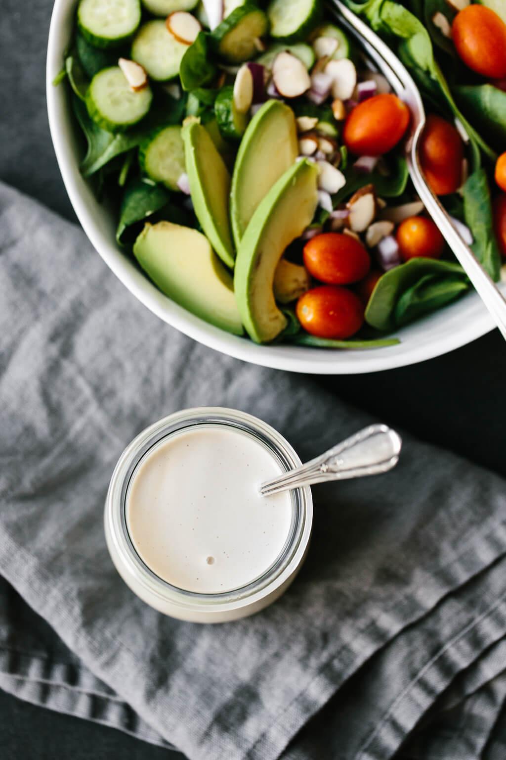This lemon tahini dressing is oil-free, dairy-free and vegan. It's a tasty, creamy, zesty salad dressing that's super versatile and adaptable. #LemonTahiniDressing #Tahini