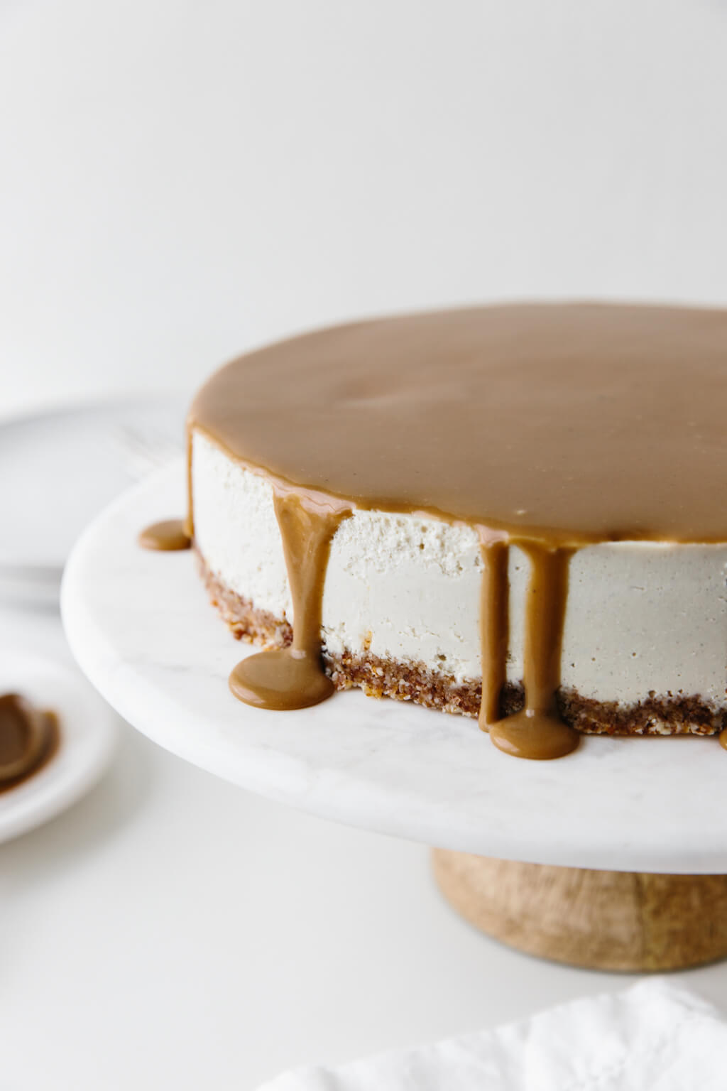 This gluten-free Vegan Caramel Cheesecake recipe is drizzled with the most amazing salted caramel sauce. The vegan cheesecake is simply made from cashews that have soaked overnight and it's super creamy and decadent.