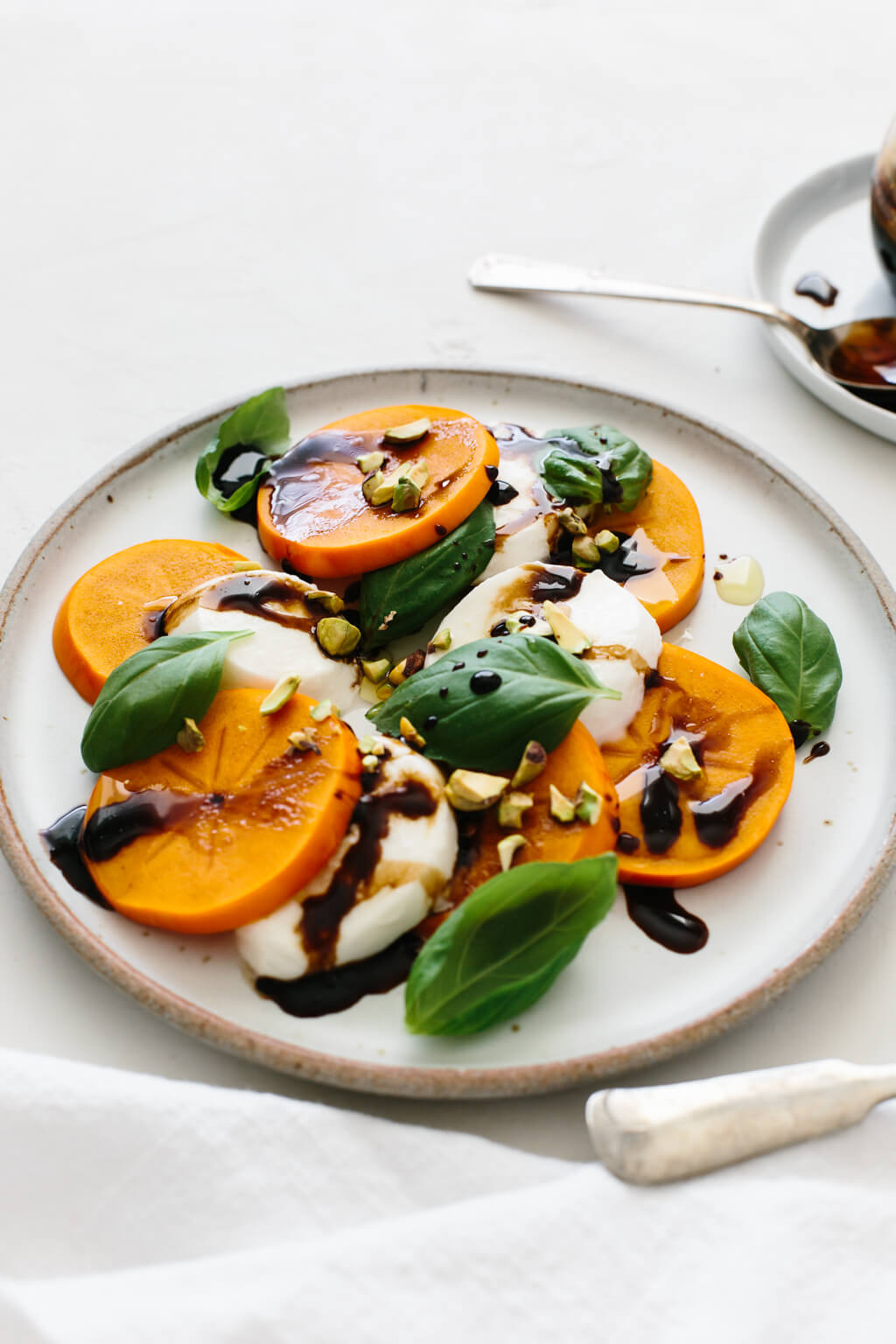 Persimmon Caprese is the perfect fall and winter appetizer or healthy salad. It's bright, flavorful, beautiful and easy to make!