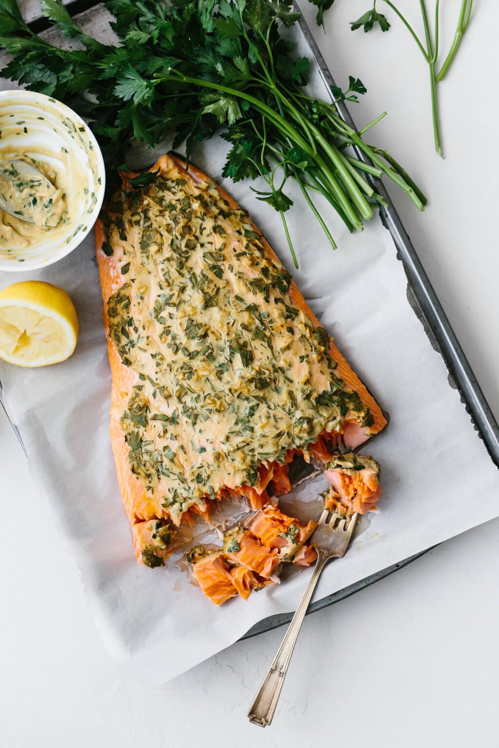 Dijon baked salmon on a baking sheet.