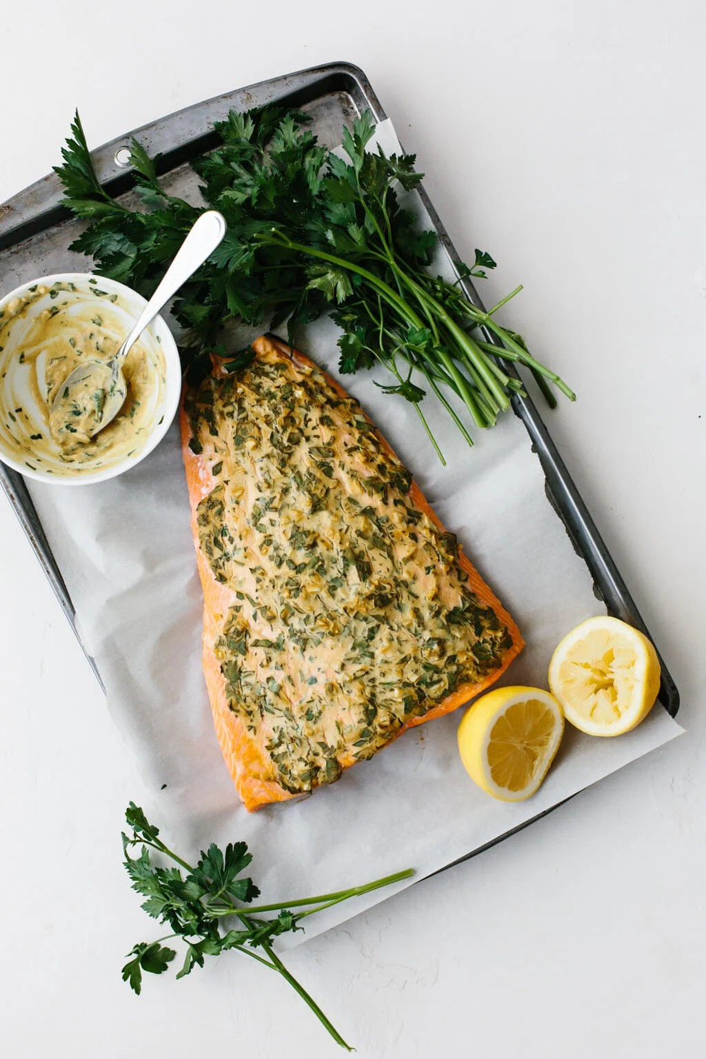 Baked salmon with Dijon on a baking sheet.
