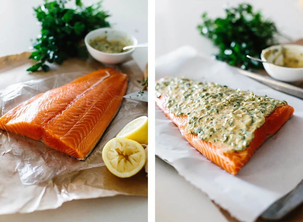 Coho salmon being covered in dijon mixture.