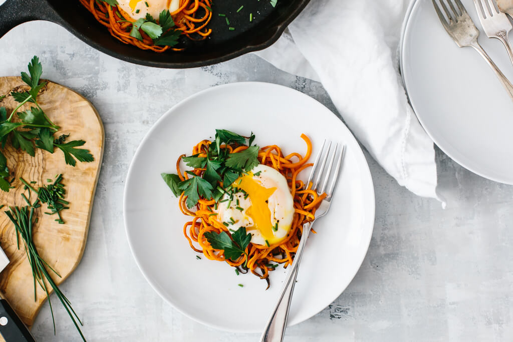 Spiralized sweet potato egg nests (and other vegetable nests) are a simple, delicious and healthy breakfast recipe. It's one of my favorite spiralizer recipes and it's perfect for a weekend breakfast or brunch.