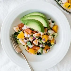 Shrimp Ceviche in a white bowl topped with avocado.