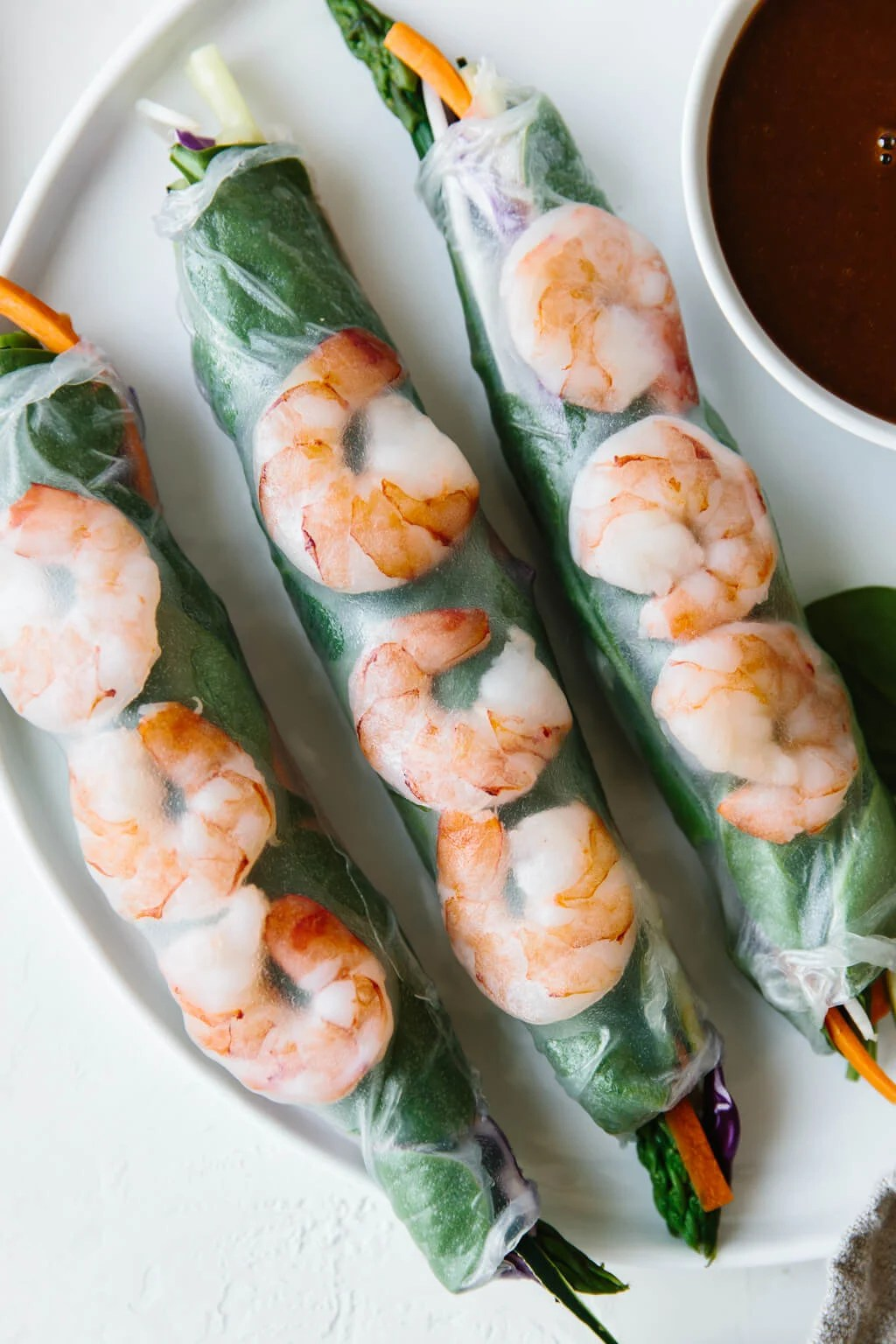 Vietnamese spring rolls filled with shrimp, spinach and vegetables and served with an almond butter dipping sauce. They're the perfect light and healthy recipe.