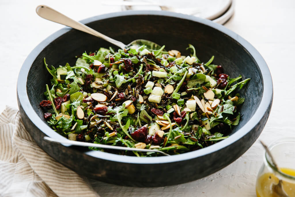 This wild rice and arugula salad takes advantage of fresh seasonal greens, including arugula, cucumber, spring onions and mint - and pairs that with the nuttiness of wild rice and sweetness of dried cranberries. It's deliciously simple and packed with flavor.