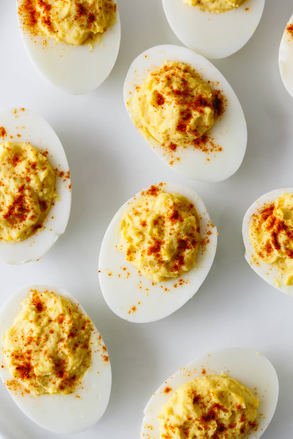 Deviled eggs on a white plate.