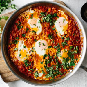 Shakshuka in a pan on a table.