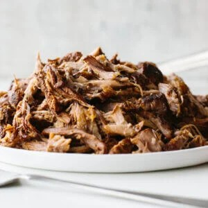 Slow cooker pulled pork is juicy, flavorful and delicious. The best slow cooker recipe!