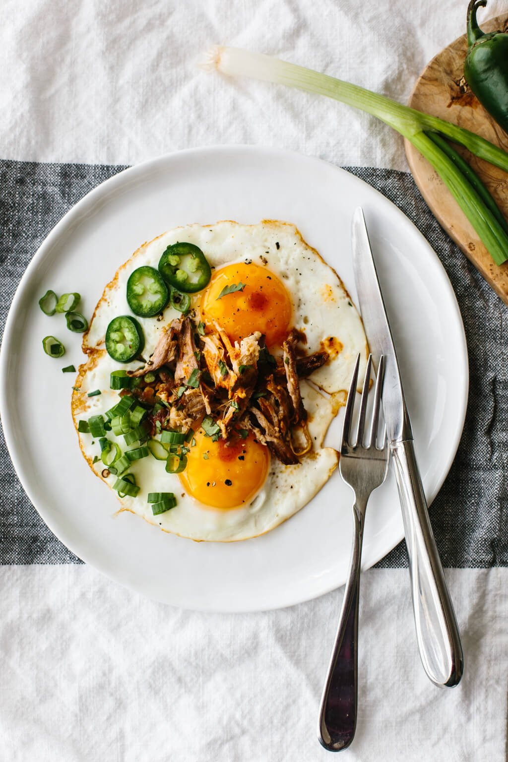 Spicy pulled pork fried eggs are a combination of hot sauce and jalapenos alongside runny eggs and flavorful pulled pork. It's a low-carb, keto, paleo, Whole30 breakfast recipe.