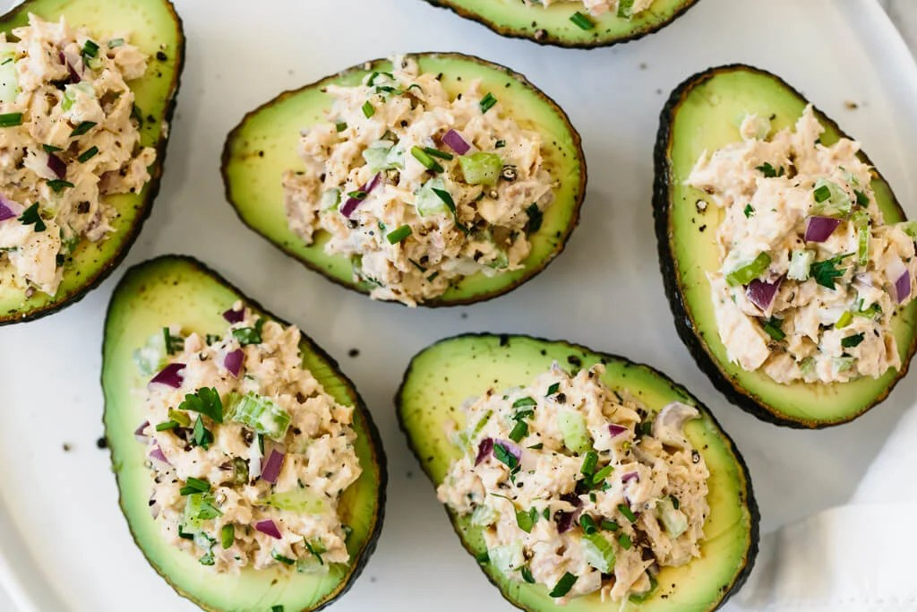Tuna stuffed avocados are a delicious low-carb, keto, Whole30 and paleo-friendly lunch or snack recipe. A simple combination of tuna salad and avocados makes for a healthy lunch recipe.