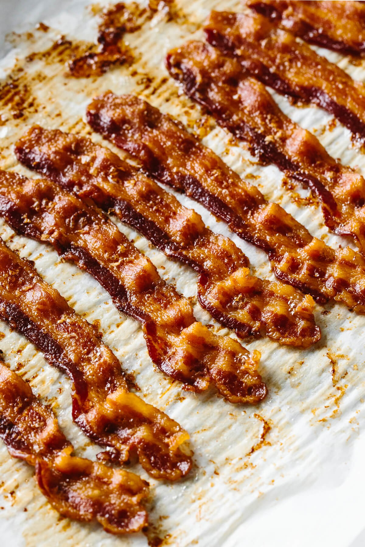 Crispy oven baked bacon on a sheet tray.