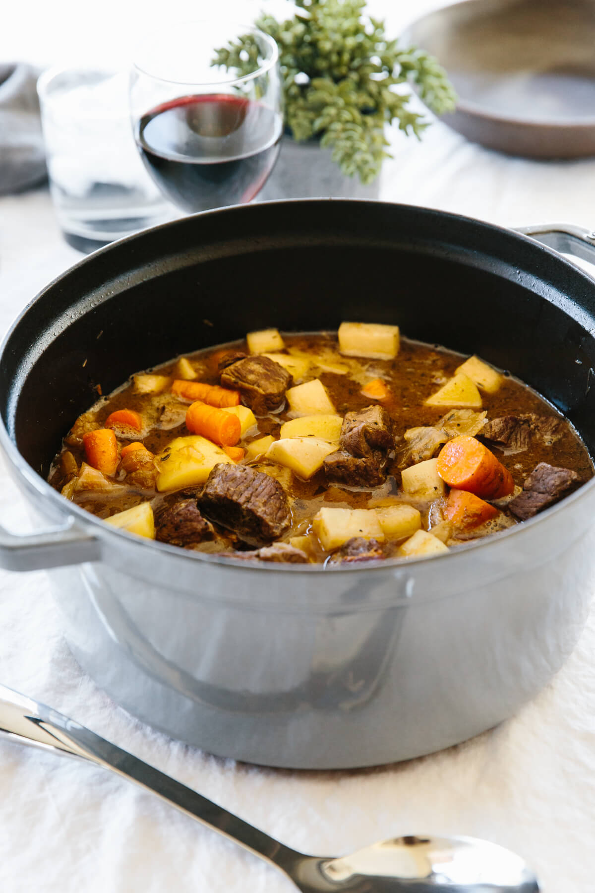 Lamb stew in a large pot.