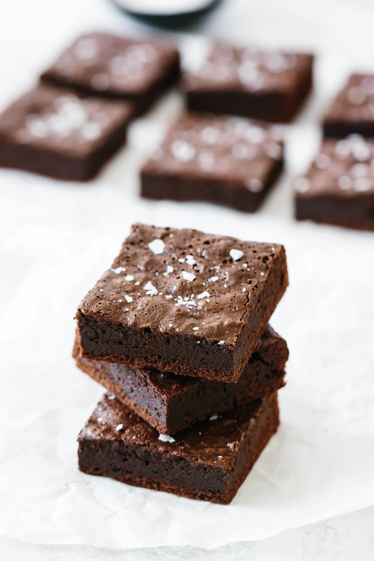 Several paleo brownies on a table.