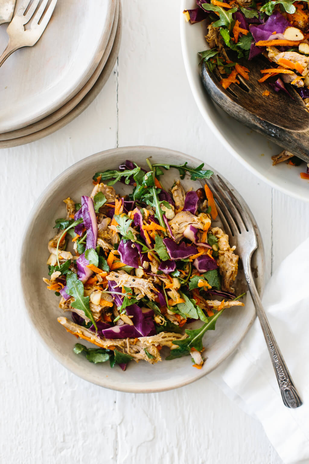 Pulled pork, cabbage and arugula salad with citrus lime vinaigrette. A hearty, flavorful and healthy salad recipe.