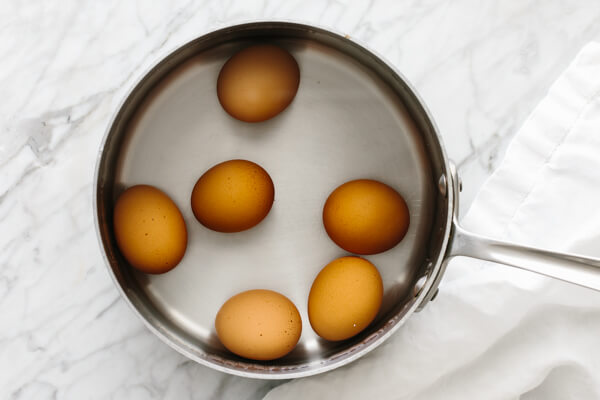 Eggs in a pot of water to boil.
