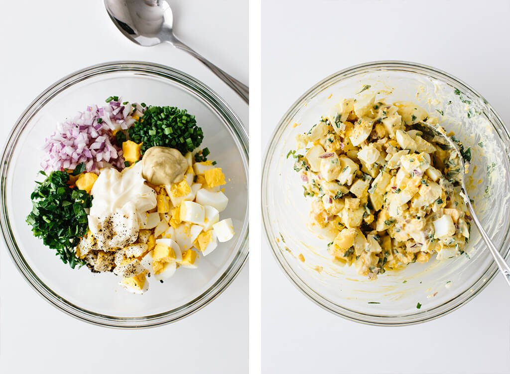 Egg salad ingredients in a bowl and then mixed.