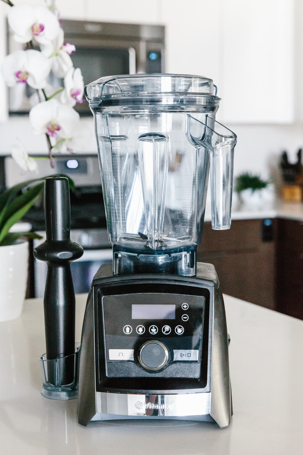 Vitamix blender sitting on a countertop.
