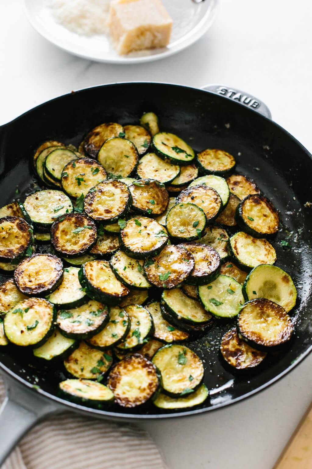 Sauteed zucchini in a pan.