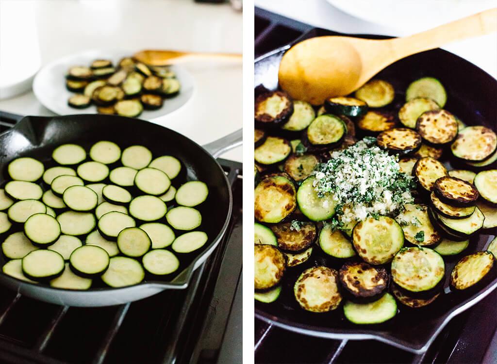 Zucchini sauteed in a pan.
