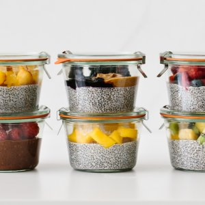 Chia pudding meal prepped with fresh fruit in glass containers.