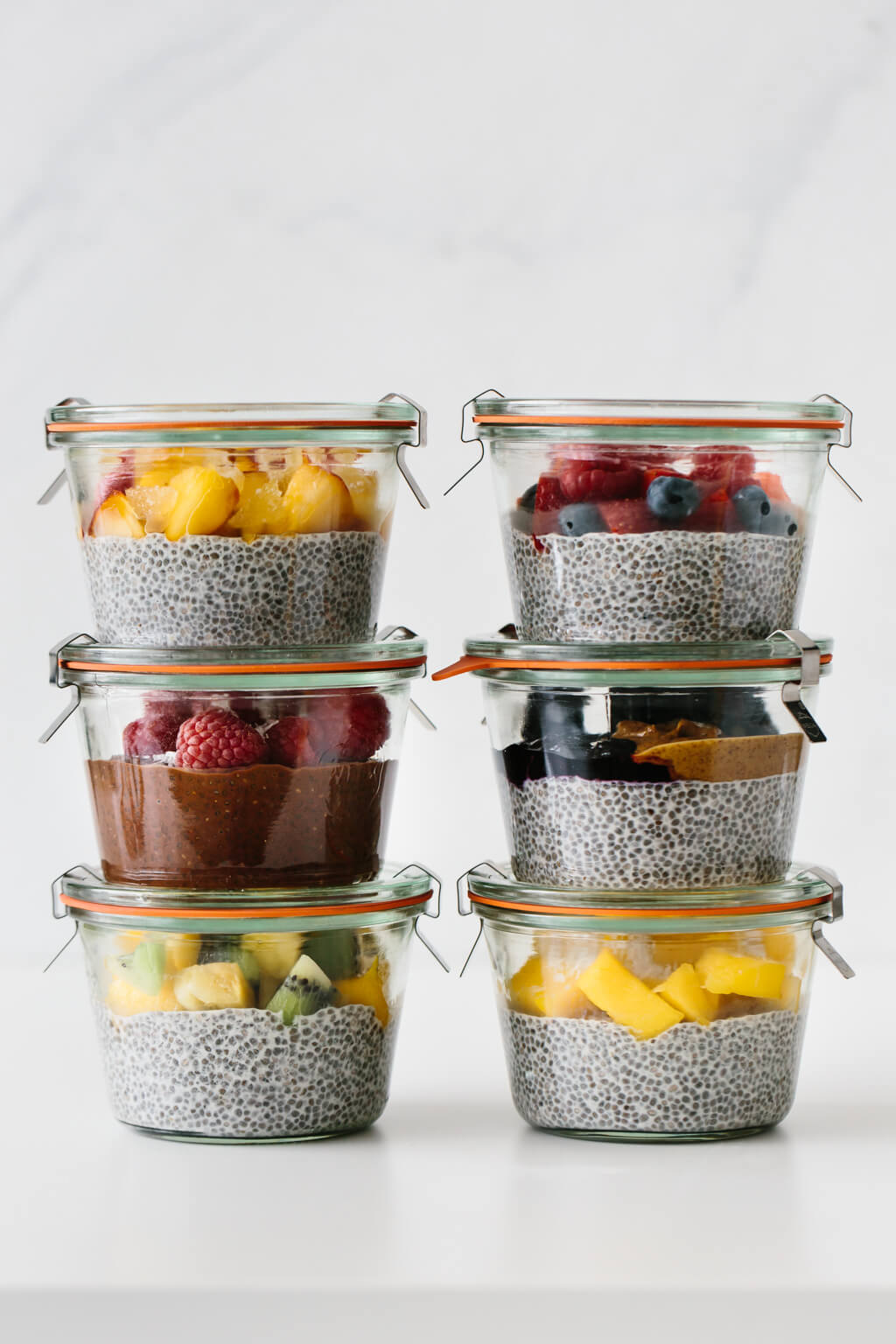 Chia pudding meal prepped into glass containers.