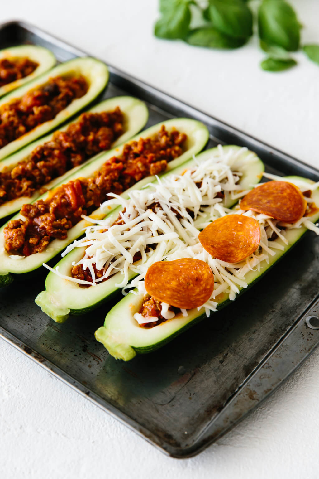 Zucchini halves stuffed with Italian sausage, mozzarella and pepperoni.