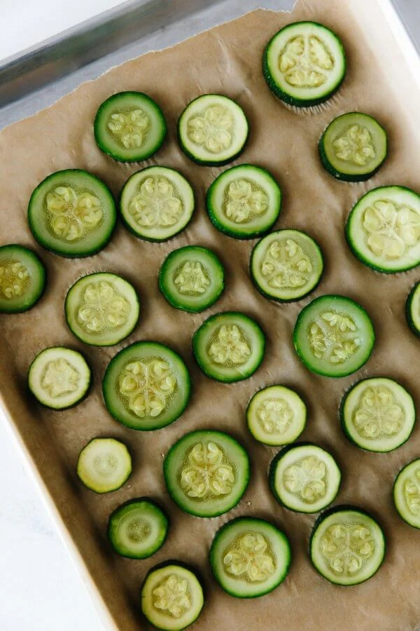 Frozen zucchini on a baking tray