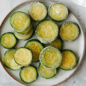 Frozen zucchini slices on a plate.