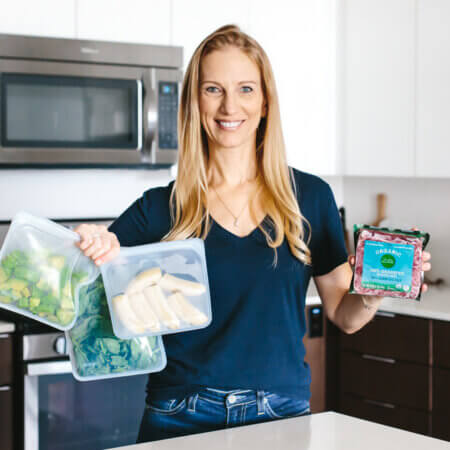 Girl holding budget friendly healthy food.