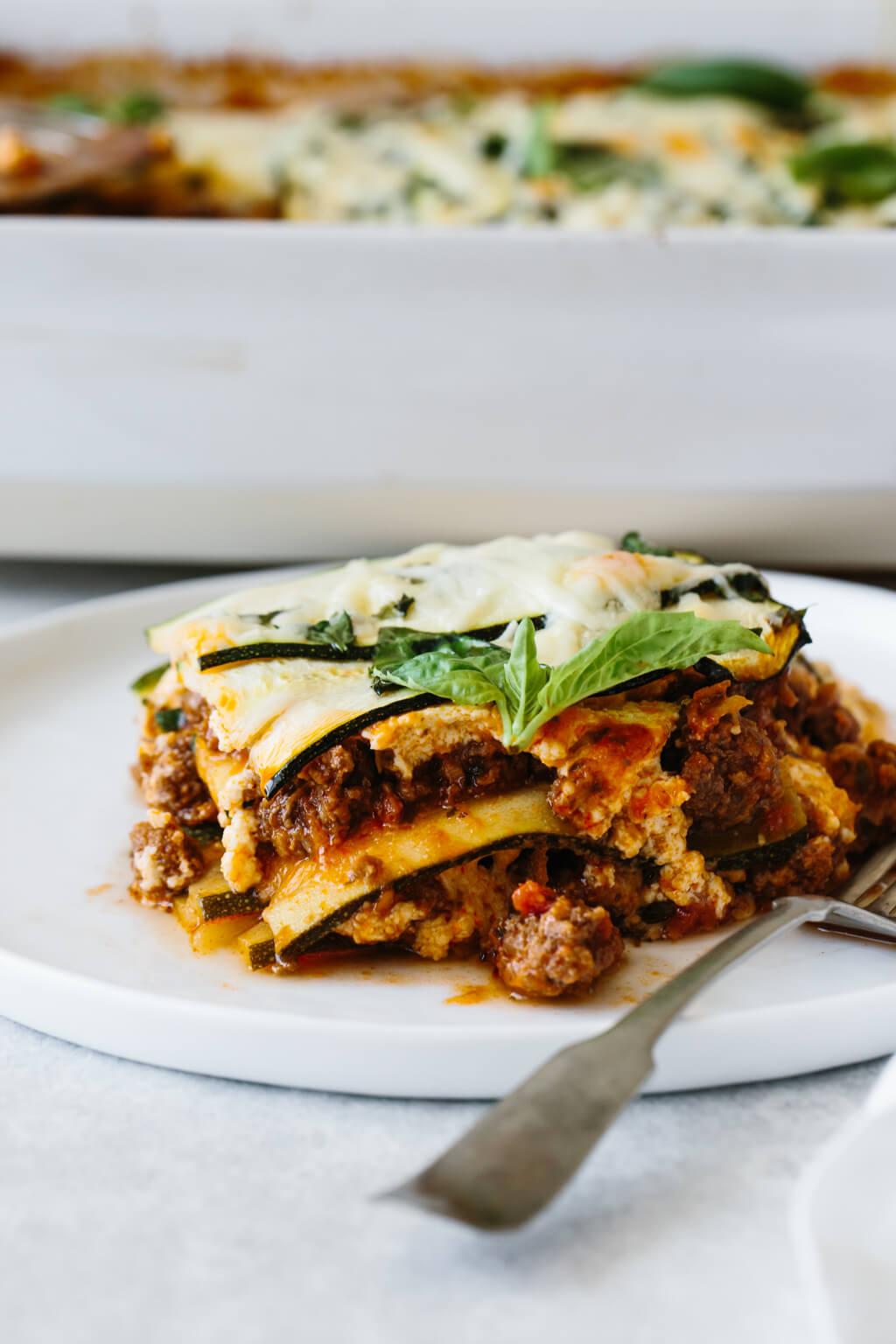 A single slice of zucchini lasagna on a plate.