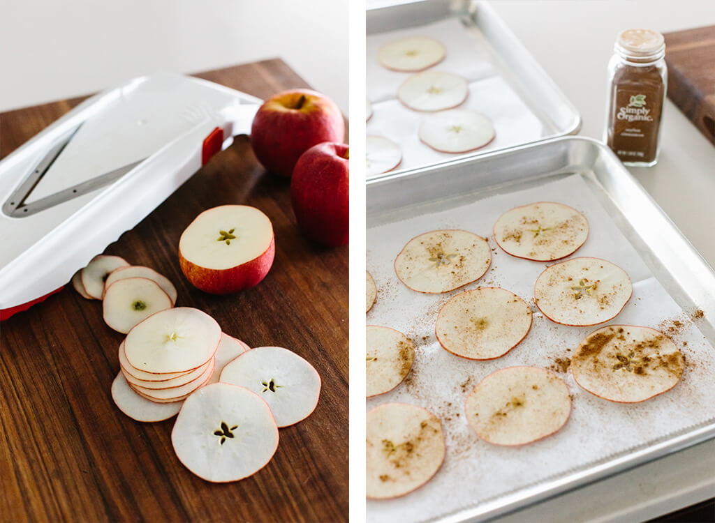 Making apple chips with a mandoline.